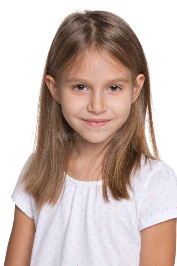女孩一点俏丽微笑 免版税库存图片