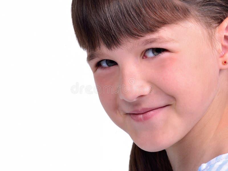 女孩一点纵向微笑 免版税库存图片