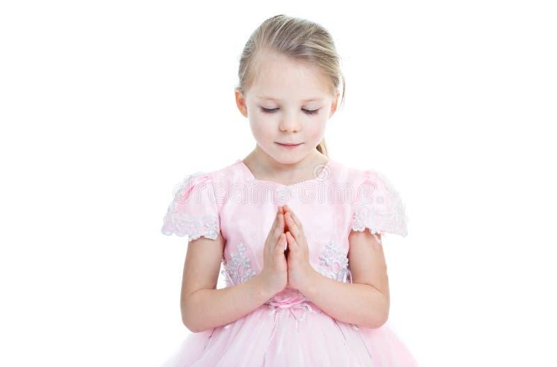 女孩一点纵向祈祷 免版税库存照片