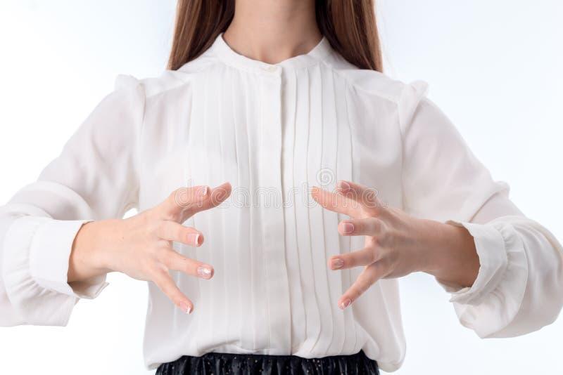 女孩举行有手指的两只手涂了特写镜头 库存照片