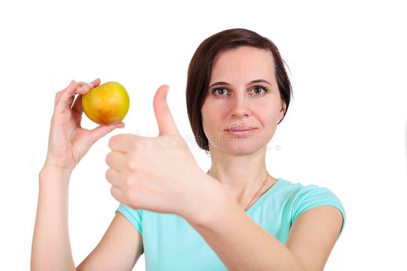 女孩举行用手手指苹果 库存图片
