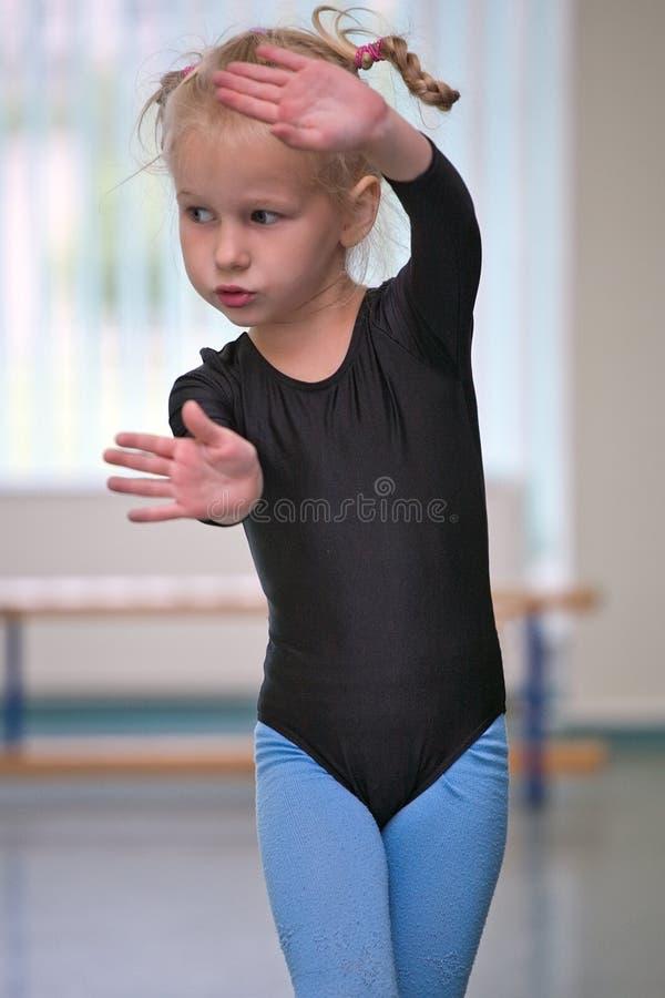 女孩体操运动员一点 免版税库存图片
