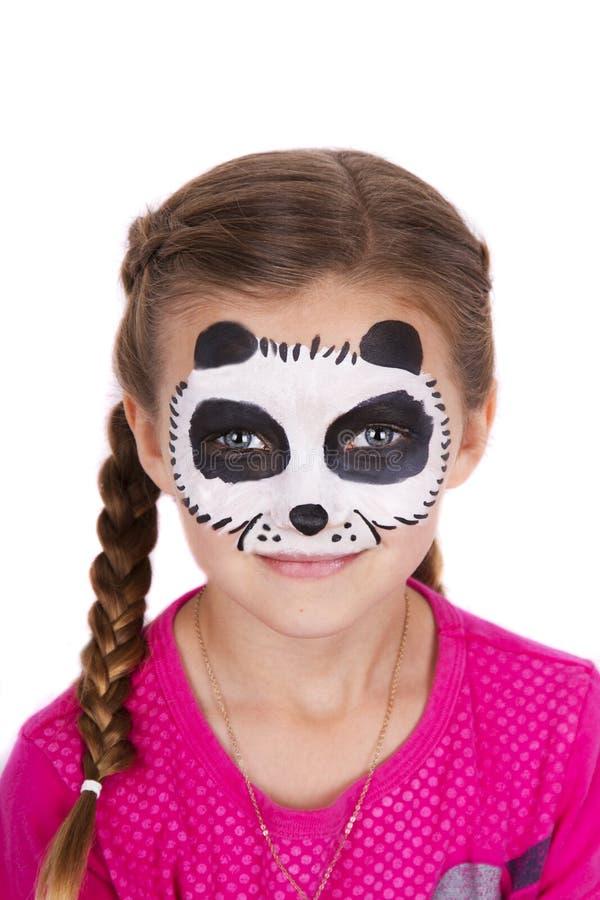 女孩佩带的熊猫狂欢节面孔油漆 免版税库存图片