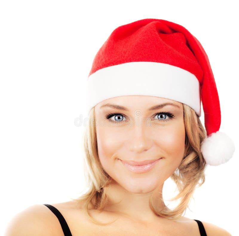 女孩俏丽的圣诞老人 库存图片