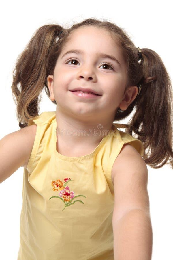 女孩俏丽的微笑的小孩 库存照片