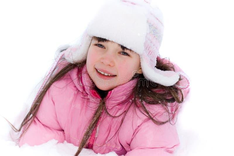 女孩俏丽的雪 免版税库存图片