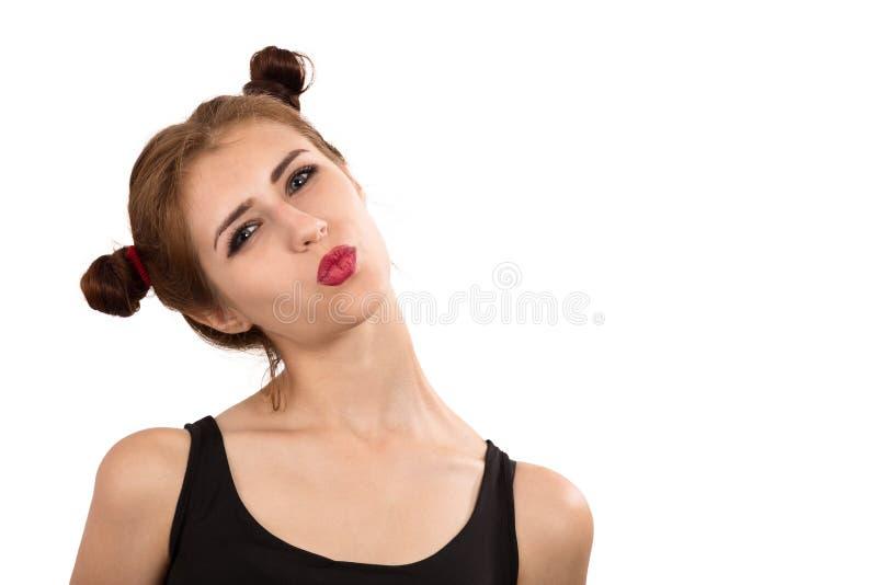 女孩做鬼脸 免版税图库摄影