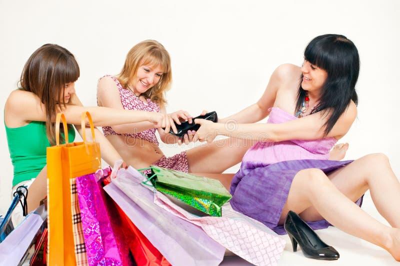 女孩共用鞋子 图库摄影