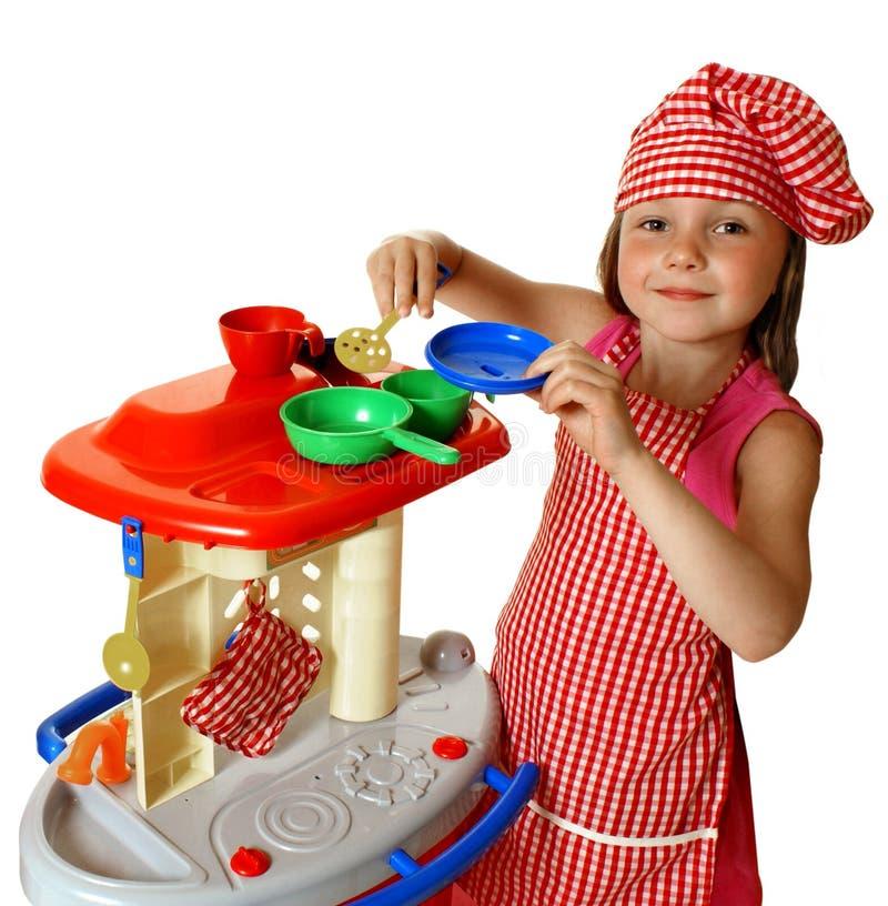 女孩厨房使用 免版税库存照片