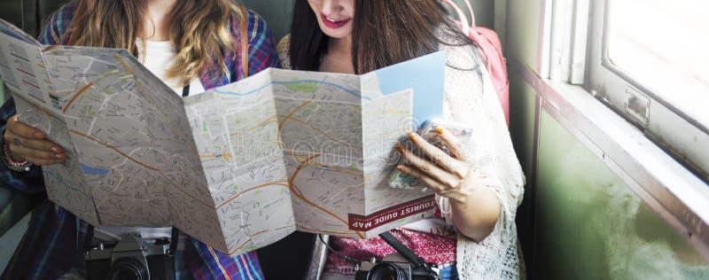 女孩友谊住处旅行的假日地图概念 免版税图库摄影