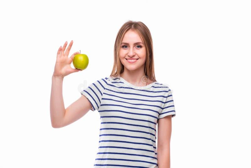 女孩吃苹果 女性牙和苹果 库存图片