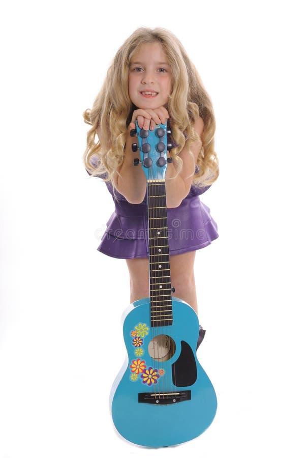女孩吉他一点 库存照片