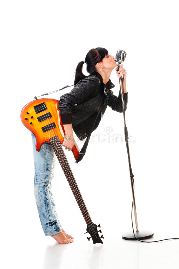 女孩吉他藏品亲吻的mi n减速火箭的岩 库存照片