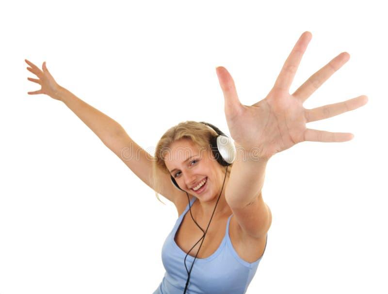 女孩听的音乐相当 免版税图库摄影