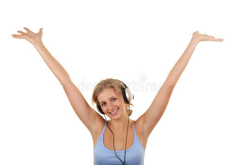 女孩听的音乐相当 图库摄影