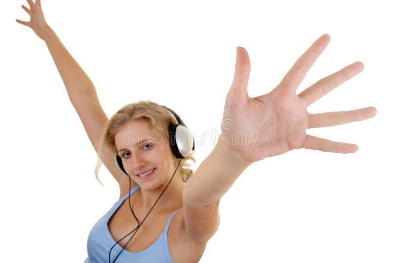 女孩听的音乐相当 库存照片