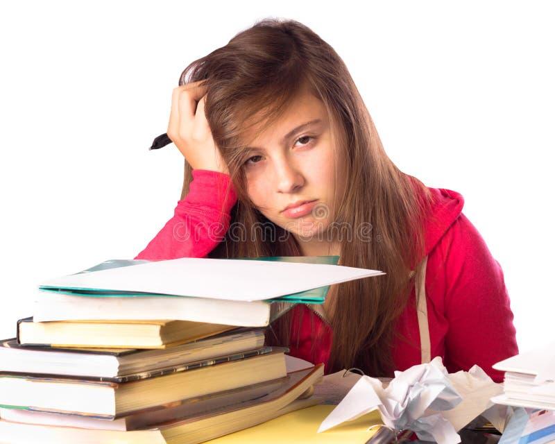 女孩和家庭作业 库存照片