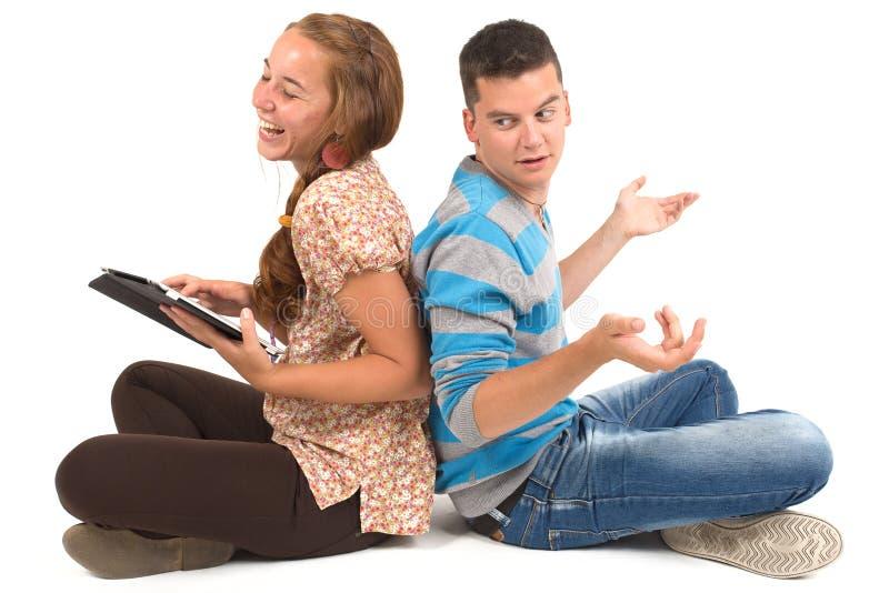 女孩和男孩有片剂的 库存图片