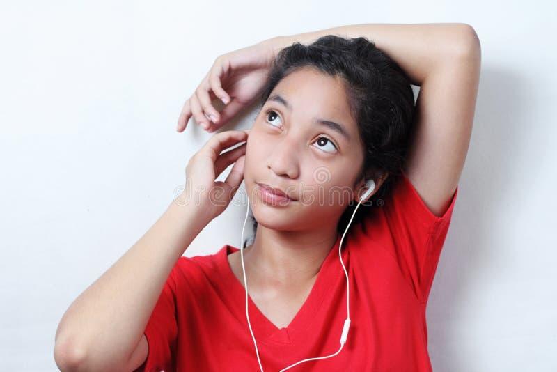 女孩和音乐 免版税库存照片