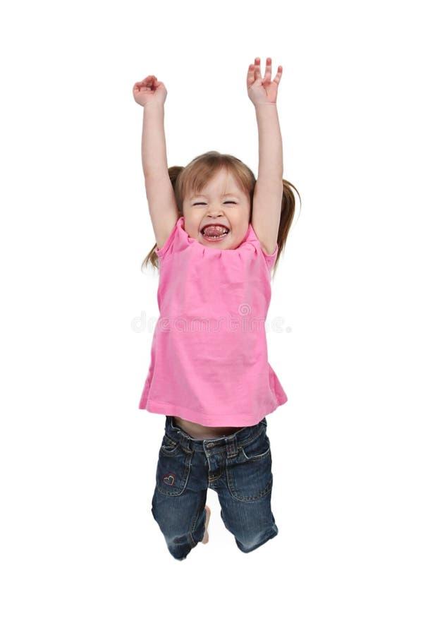 女孩喜悦跳 库存照片