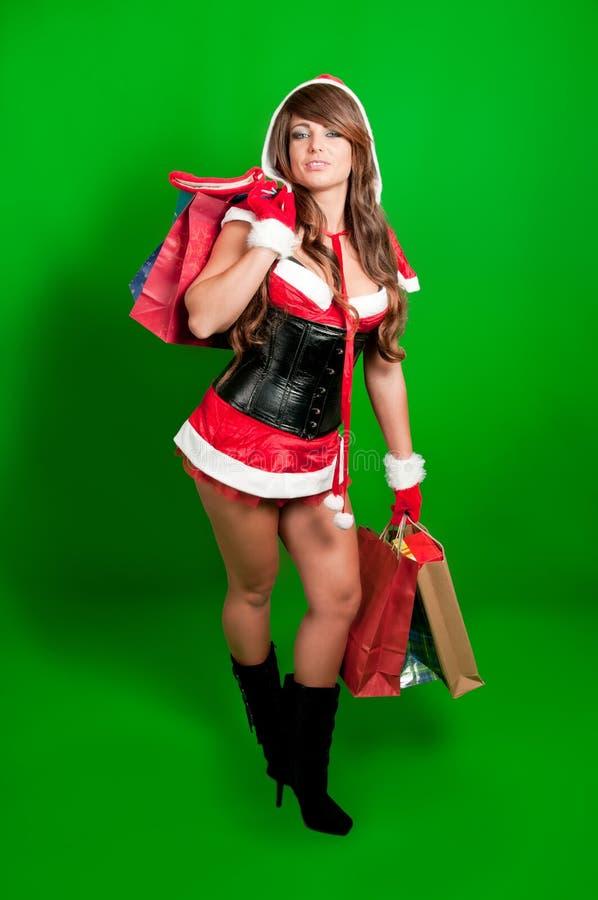 女孩圣诞老人性感的购物 免版税库存照片