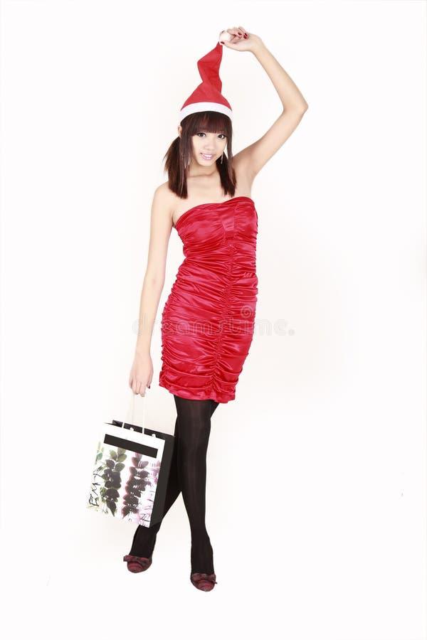 女孩圣诞老人购物 库存照片