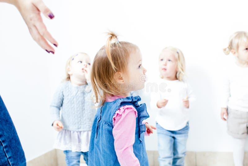 女孩在幼儿园 免版税库存图片