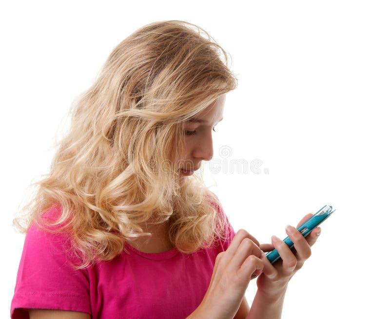 女孩在手机拨号 库存图片