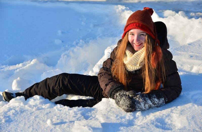 女孩在雪冬天 库存照片
