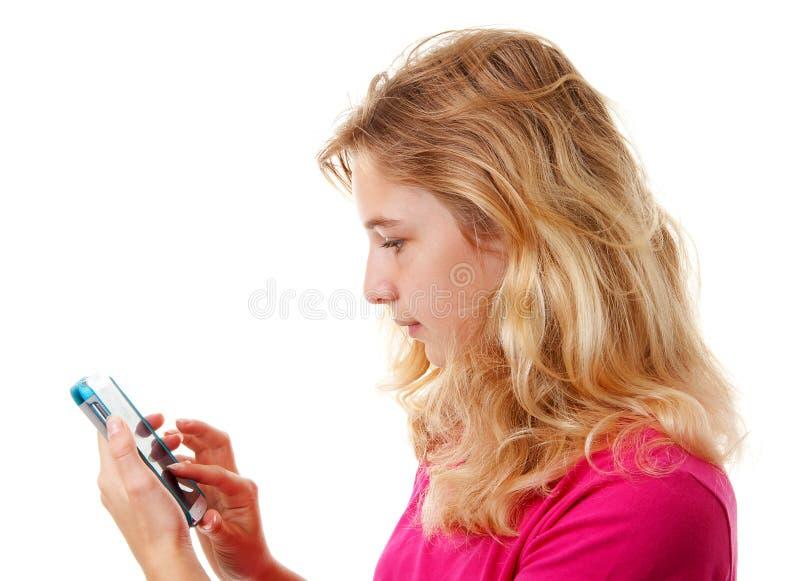 女孩在mobilesmart电话拨号 库存照片