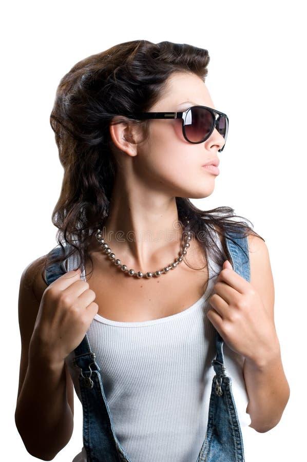 女孩头发壮观的俏丽的岩石 免版税库存图片