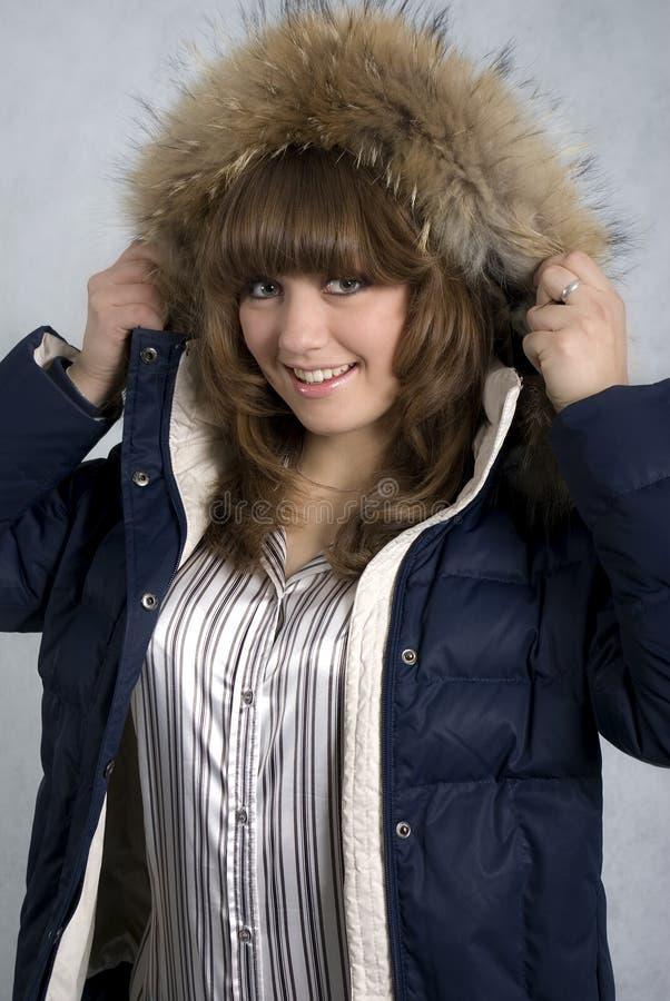 女孩夹克微笑的冬天 图库摄影