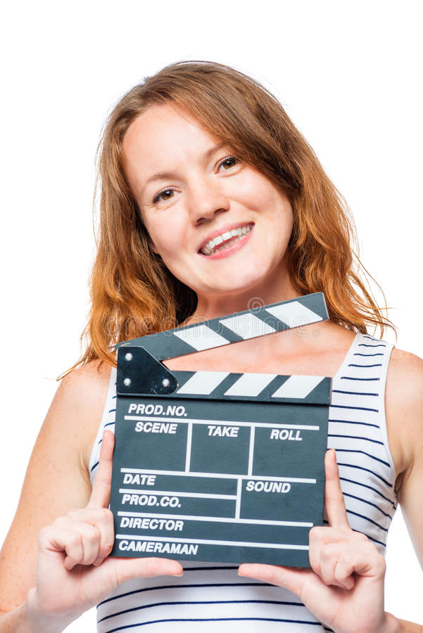 女孩女演员和电影拍板在手中在白色 库存图片