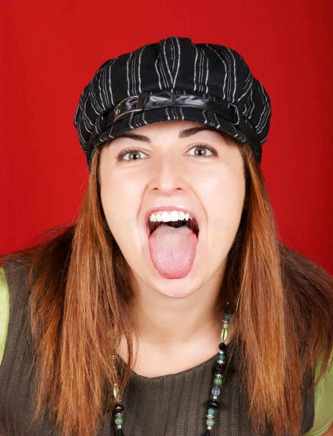 女孩她的伸出的舌头年轻人 库存图片
