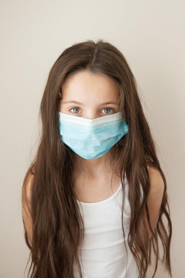 女孩孩子流行性流感医学儿童医疗面具 库存图片