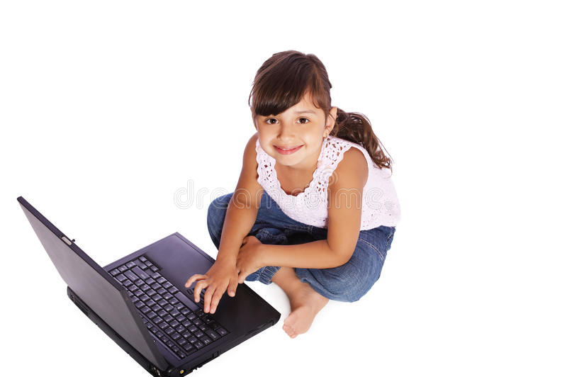 女孩孩子膝上型计算机 免版税库存图片