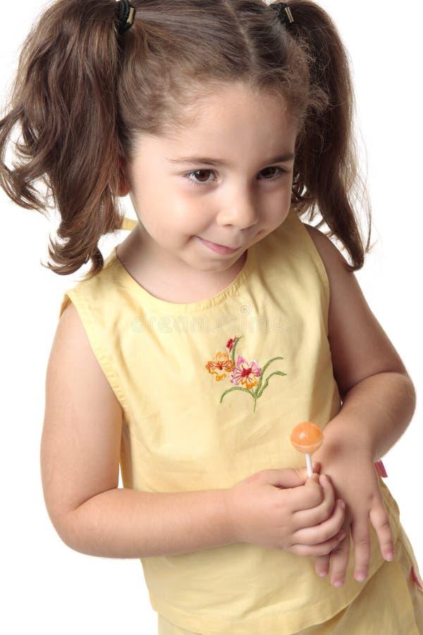 女孩害羞的微笑的小孩 库存图片