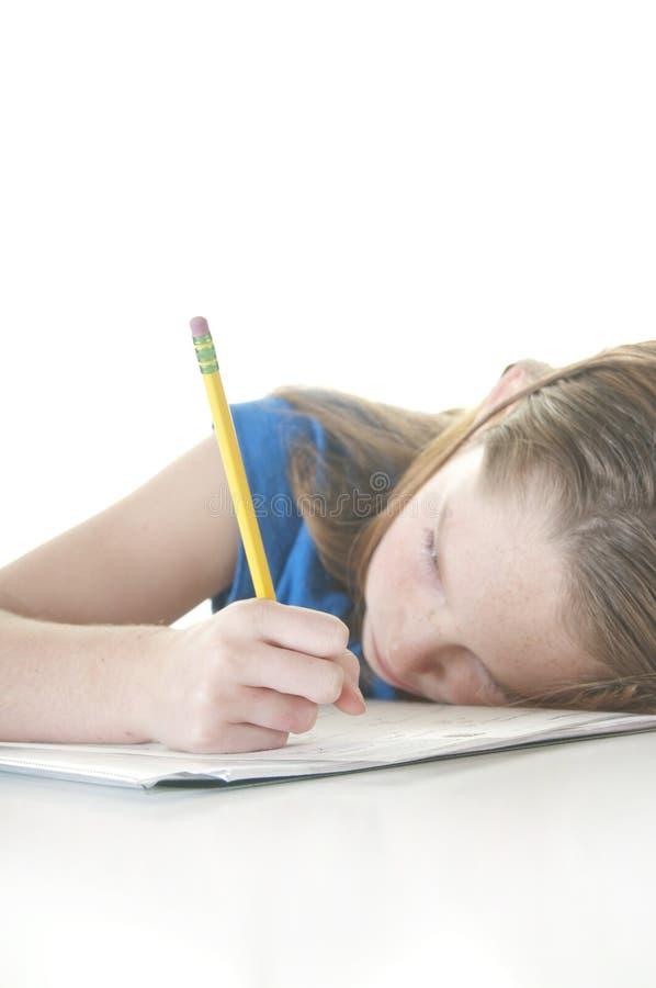 女孩家庭作业运作的年轻人 免版税库存图片