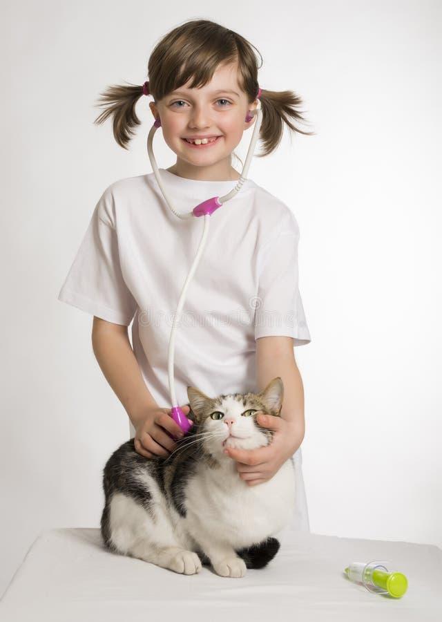 女孩小使用的狩医 免版税库存图片