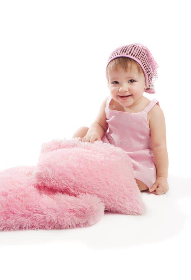 女孩小的枕头 免版税库存图片