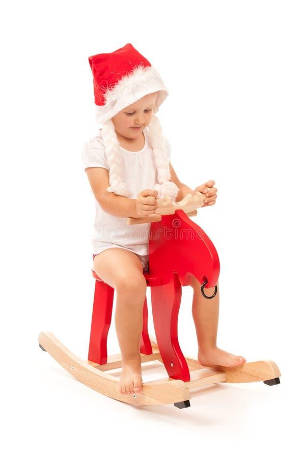 女孩小的红色驯鹿工作室 库存照片
