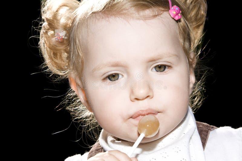 女孩少许棒棒糖甜点 库存图片
