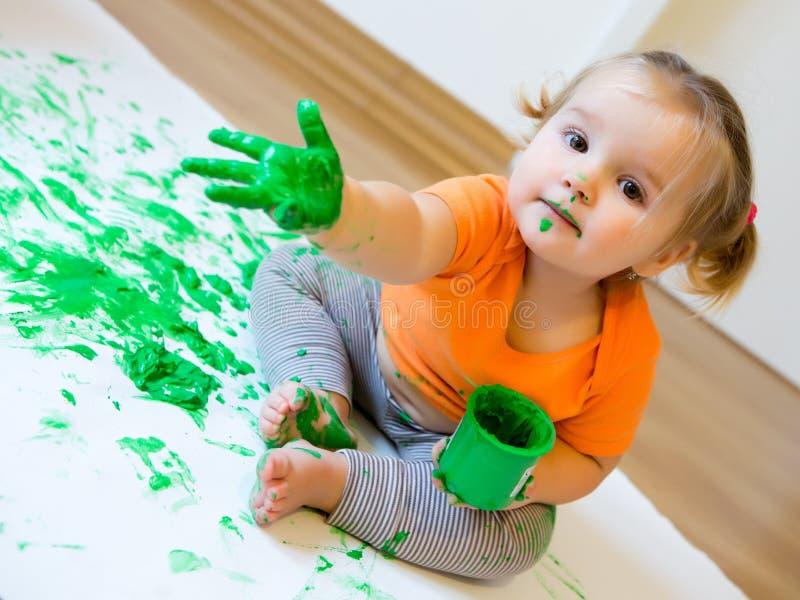 女孩少许油漆 库存照片