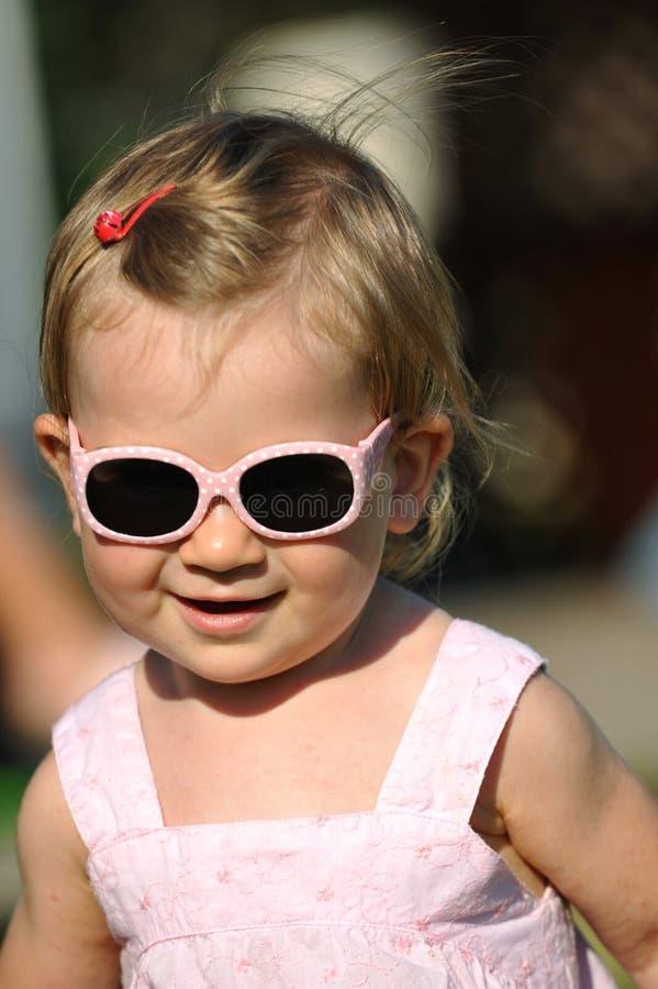 女孩少许纵向太阳镜 库存照片