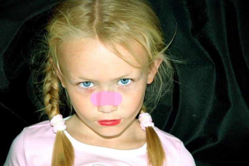 女孩少许鼻子膏药 免版税库存图片