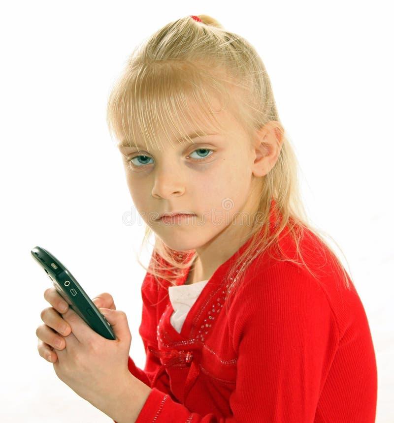 女孩巧妙藏品的电话 库存图片