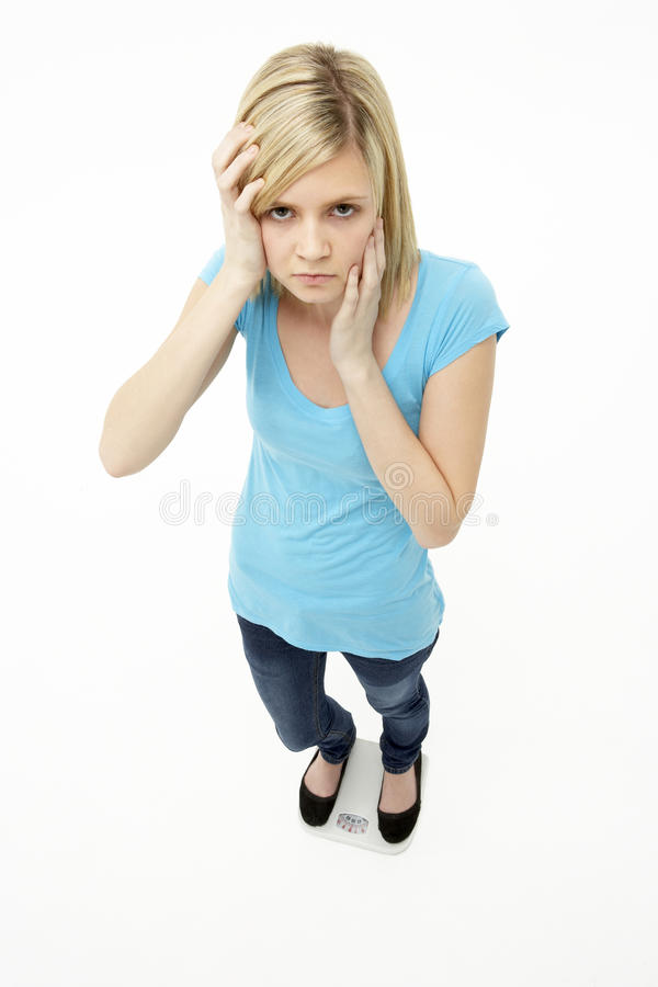 女孩常设工作室少年担心 免版税库存照片