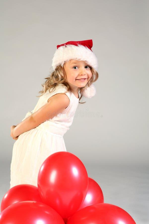 女孩帽子圣诞老人微笑 免版税库存照片