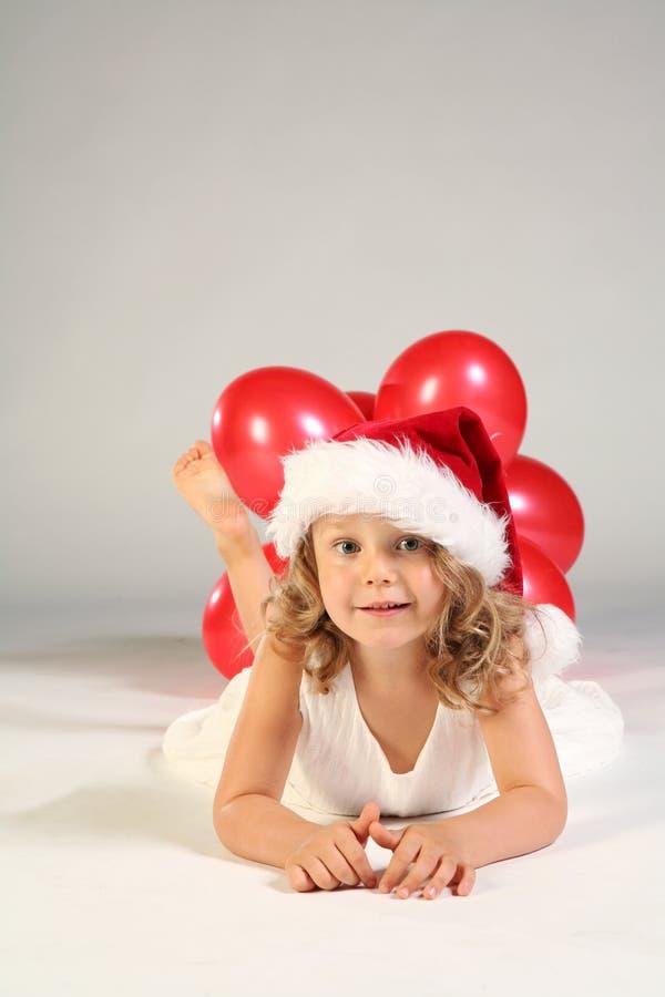 女孩帽子小的圣诞老人 免版税库存照片