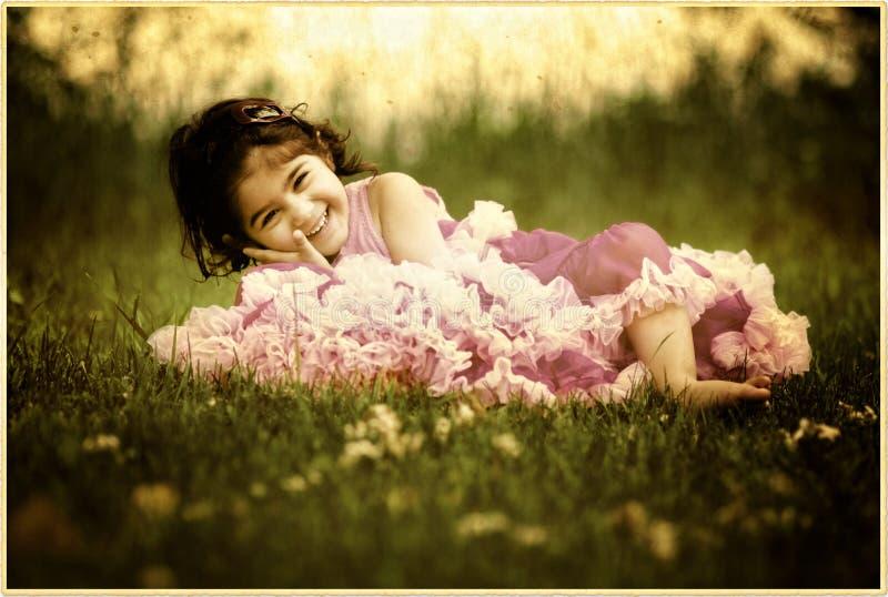 女孩微笑的一点 图库摄影